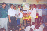 Free distribution of notebooks to students in remote villages of Maharashtra